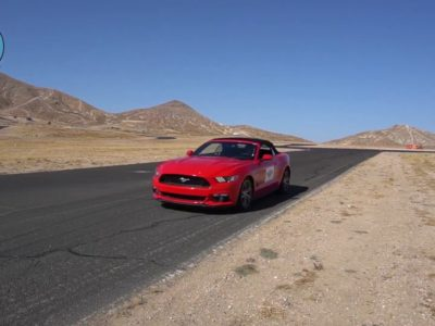 red car on vehicle training track for Evasive Defensive Driving course at PWA.edu