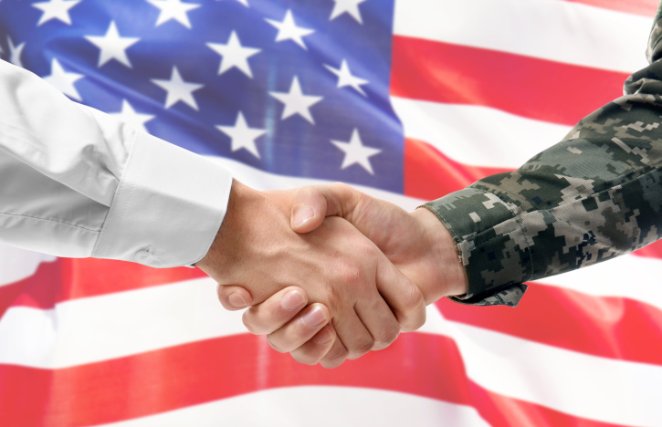 handshake in front of american flag - How to Use Your GI Bill® to Advance Your Civilian Career