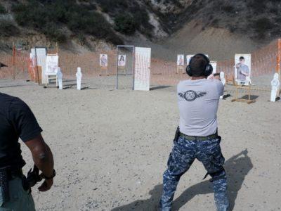 teacher overseeing a students in PWA's Handgun Shooting Tactics course