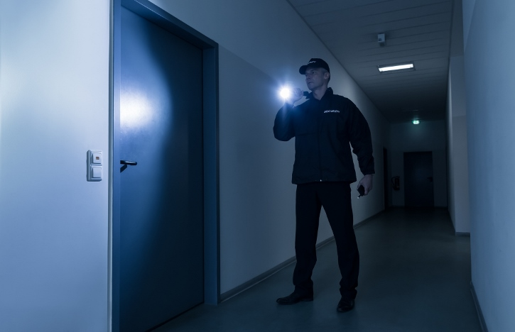 security guard in searching a hallway carrying his california guard card