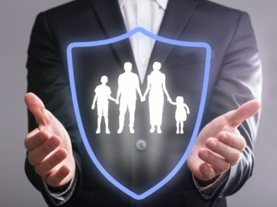 Man holding virtual shield protecting family - Why private personal security might be for you