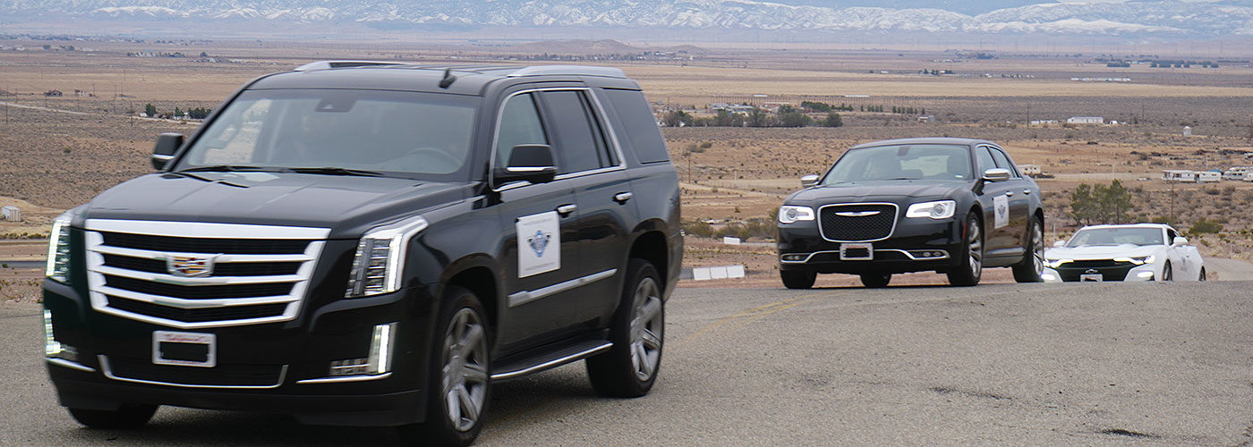 Car traveling in formation for security training - About PWA's Security Training Academy